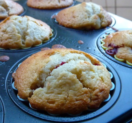 damson muffins in cake tin close up