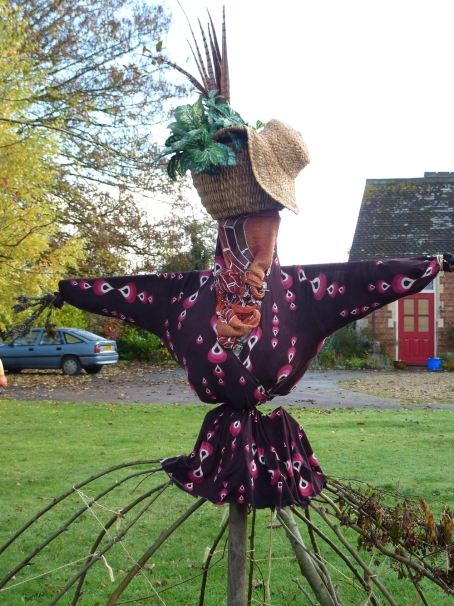 Apple picking scarecrow