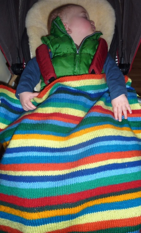 13-1-13 - E sleeping under smiley stripes blanket 4B