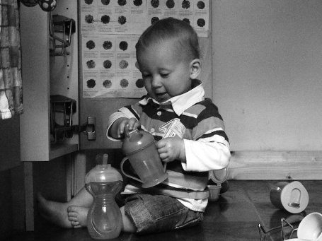 CUP - E playing in cup cupboard