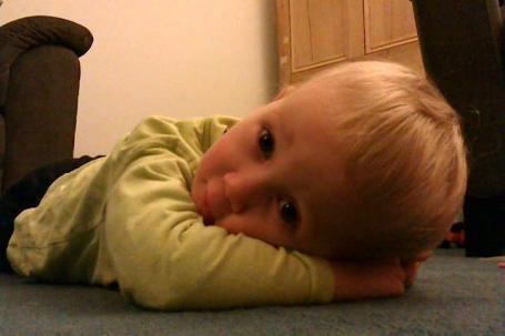E poorly lying on carpet