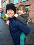 6 year old boy having a piggyback from Mummy