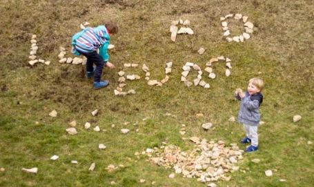 Easter sunday walk Selsley common_boys making names using rocks - nipitinthebud.co.uk