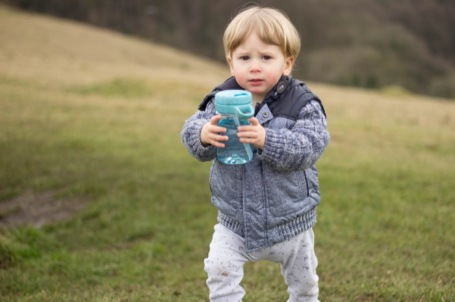 toddler holding OXO twist top water bottle on Selsley Common