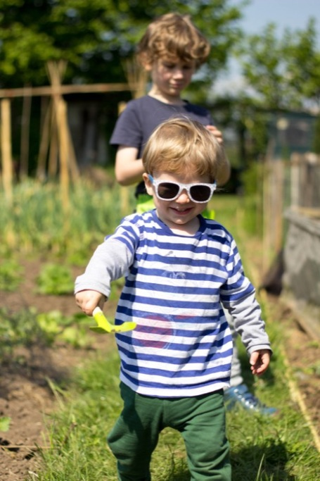 toddler running at the allotment